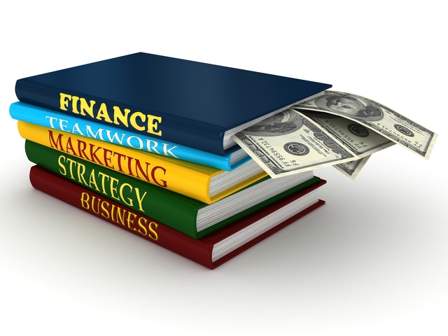 Business books with money